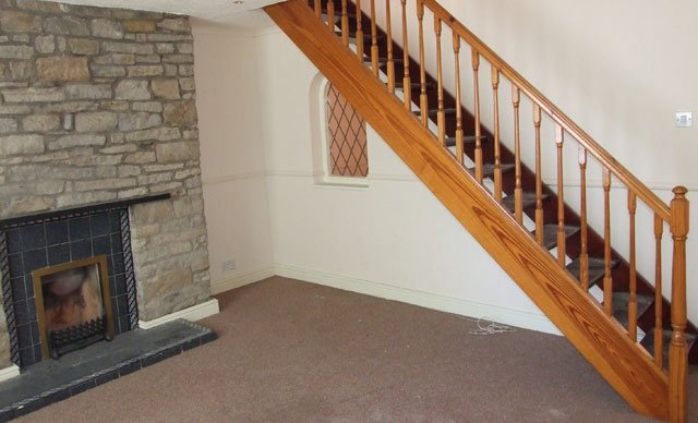 fireplace and staircase need updating